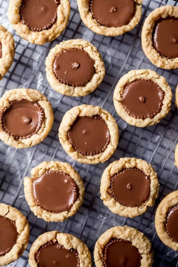 Peanut butter cup cookies cooling on a cooling rack