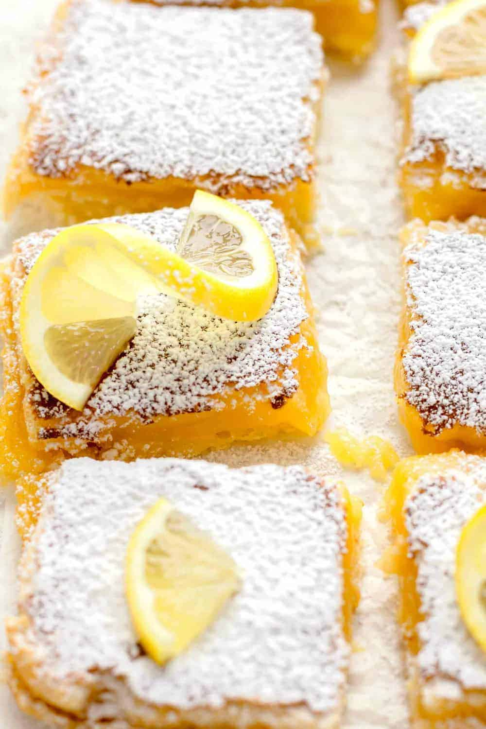 Close-up overhead view of sliced homemade lemon bars dusted with powdered sugar