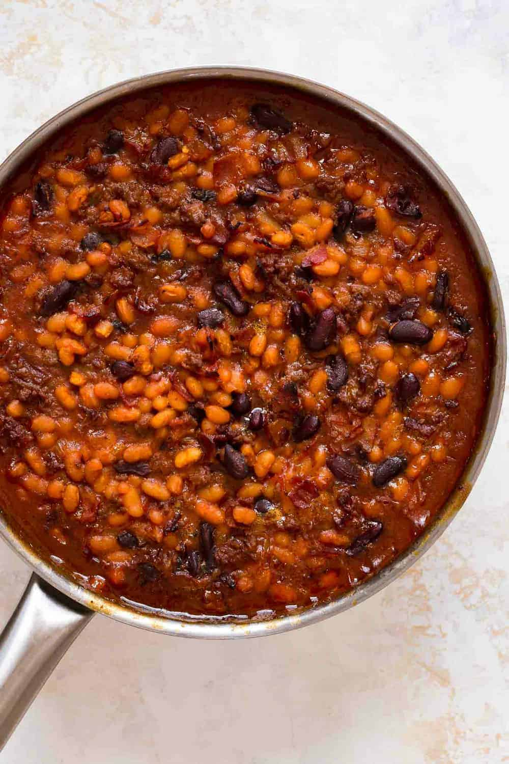 Skillet of old fashioned baked beans fresh from the oven
