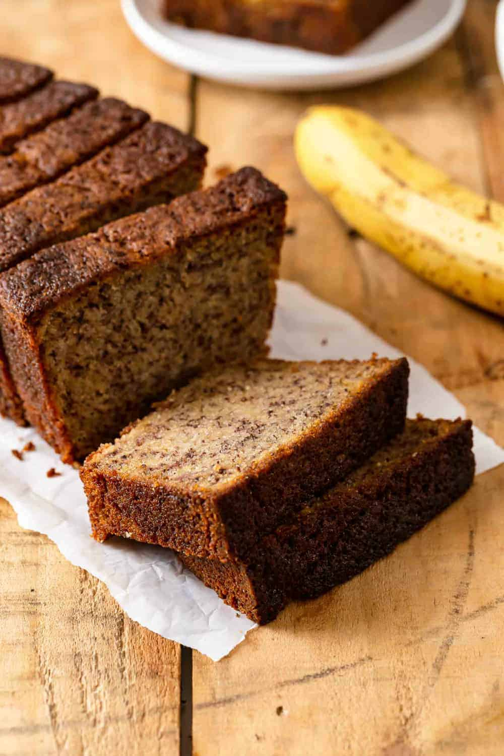 Sliced loaf of Dominique Ansel's banana bread, ready to serve