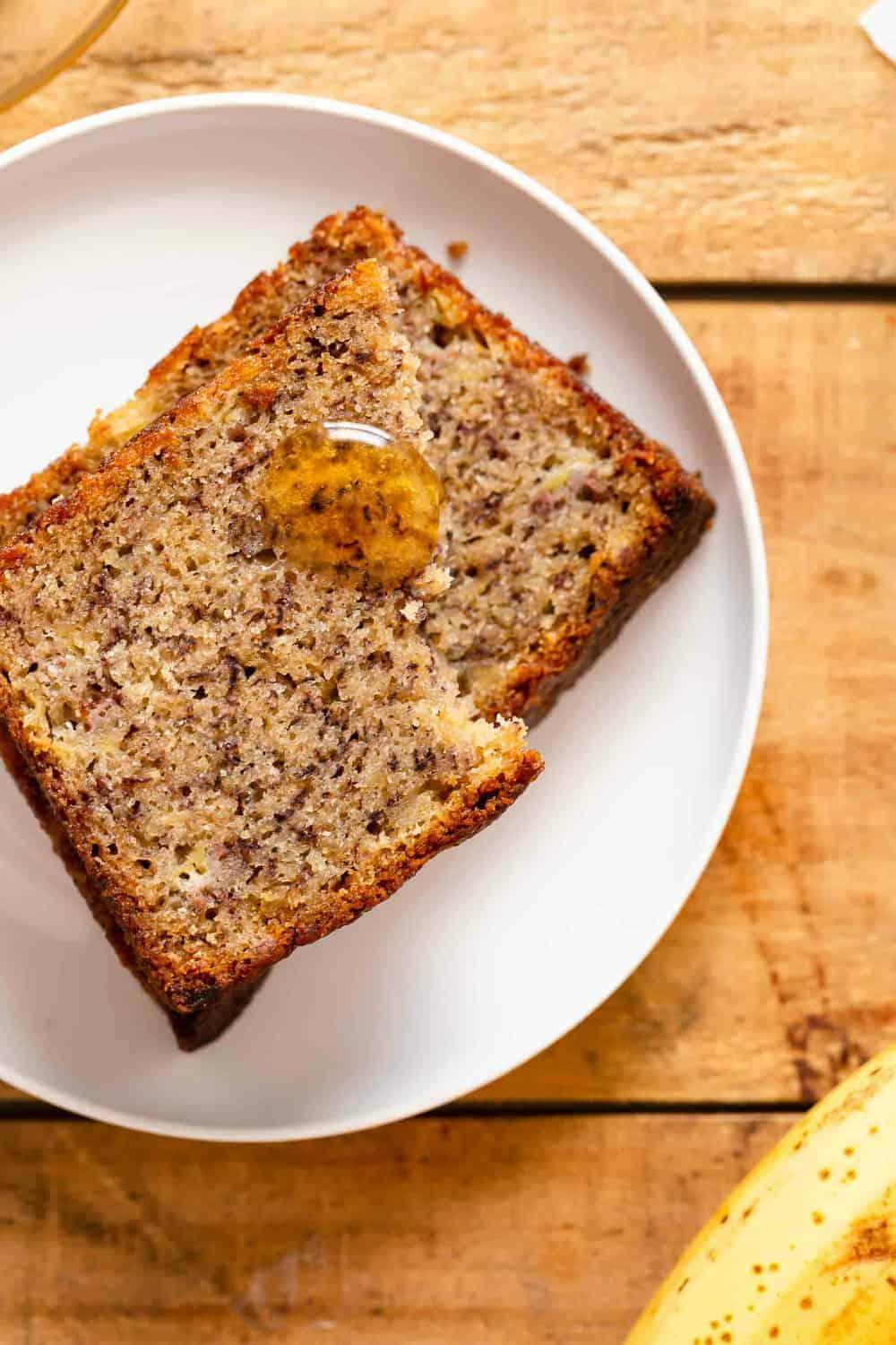 Slices of Dominique Ansel's banana bread, drizzled with honey