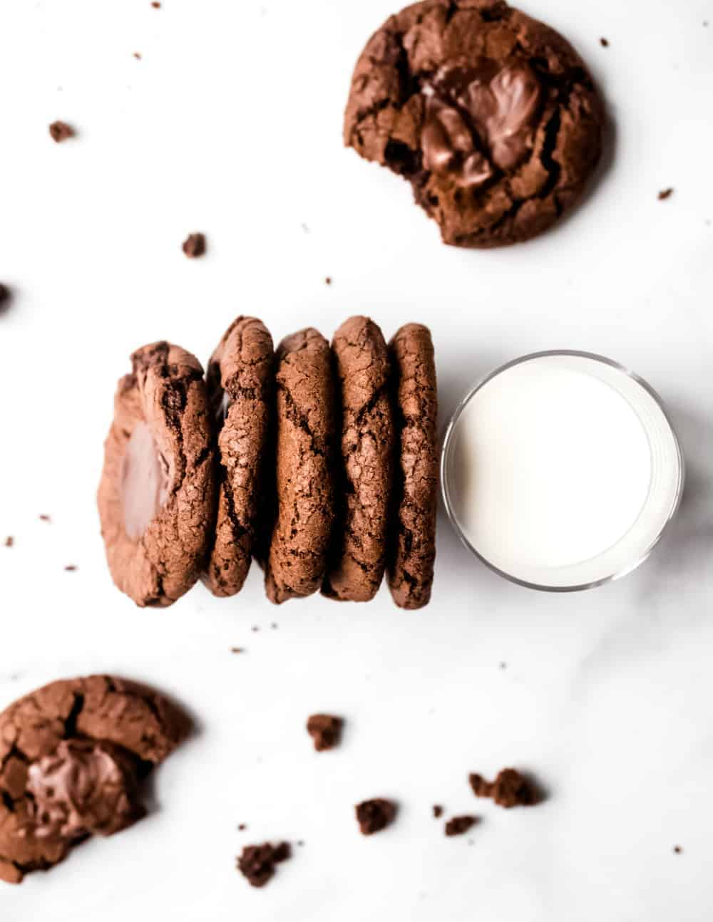 5 Mint chocolate cookies lined up against a glass of milk