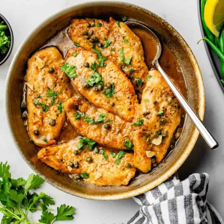 Chicken Piccata in a pan ready to serve