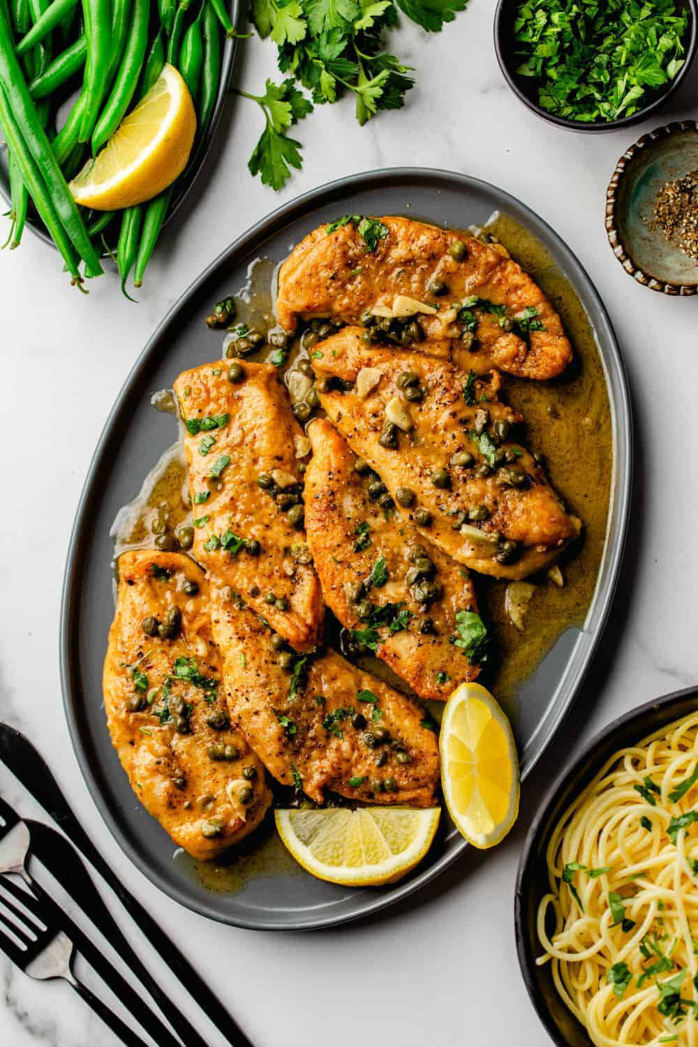 The bright flavor of lemon juice and the brininess of capers come together in the best way in this Chicken Piccata recipe. It is easy to make for a weeknight dinner but special enough to serve to company!