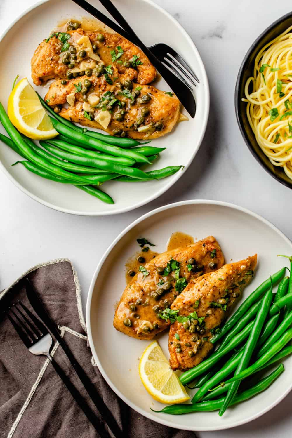 Serve Chicken Piccata with buttered pasta and a green vegetable for a complete, delicious meal.