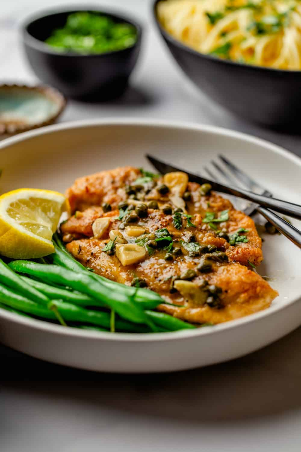 Lemon, garlic, capers and white wine make a delicious sauce for Chicken Piccata