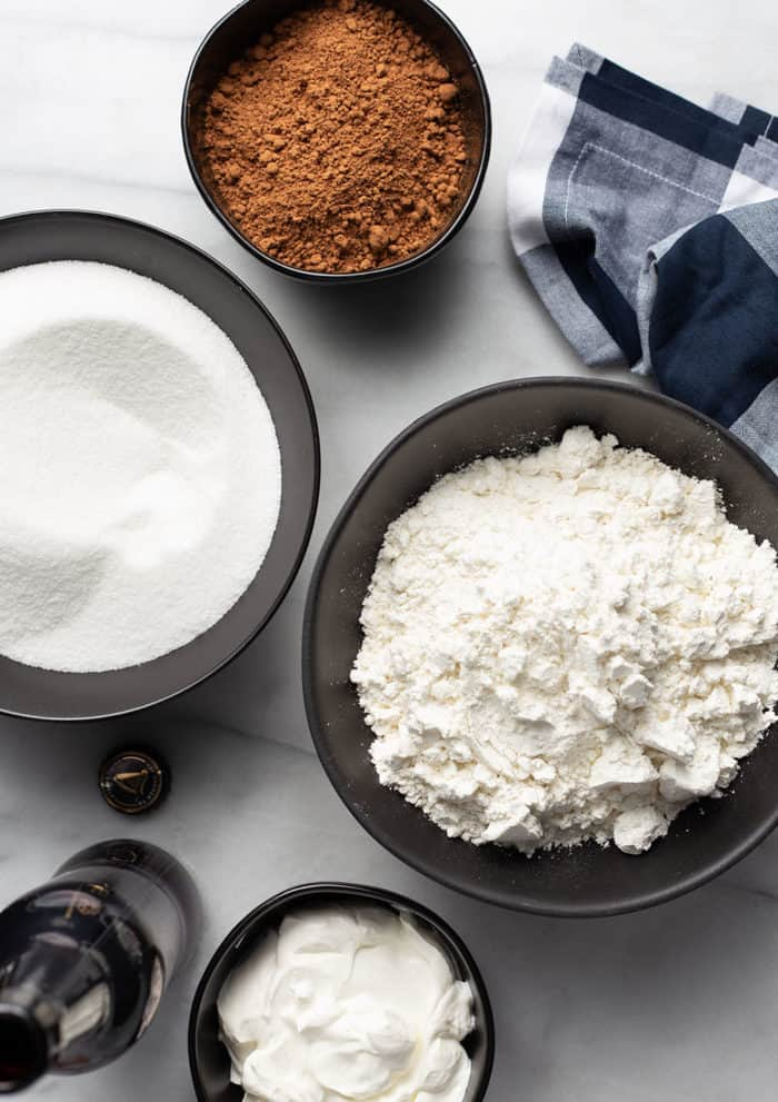 Dry ingredients for guinness cupcakes arranged on a marble counter