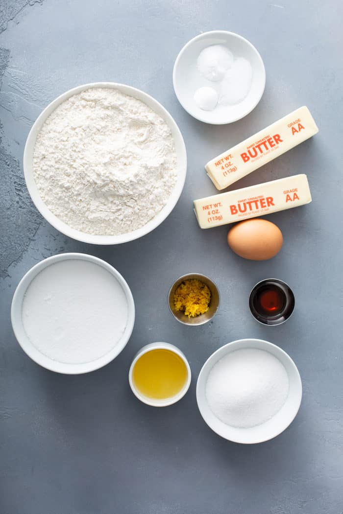 Ingredients for chewy lemon sugar cookies arranged on a gray countertop