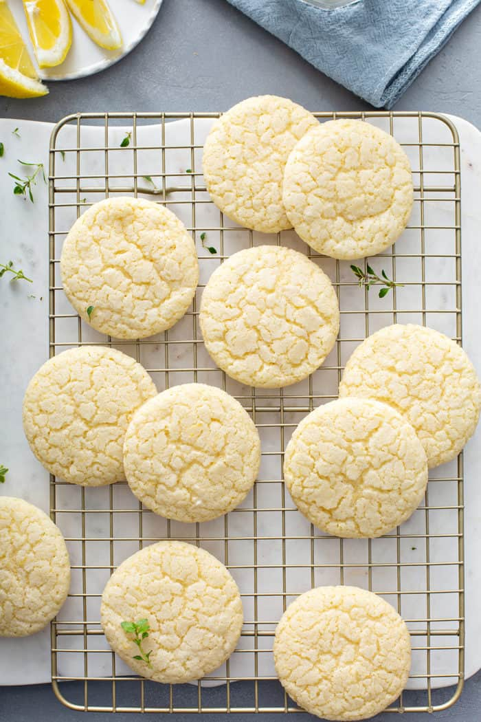 Overhead view of chewy lemon sugar cookies on a wire cooling rack