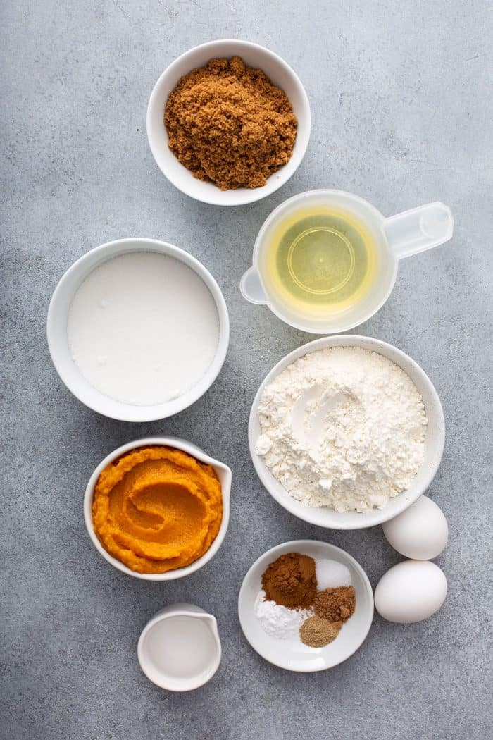 Overhead view of ingredients for butternut squash bread on a gray countertop