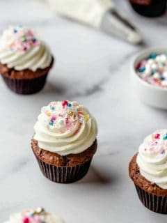 Cupcake with homemade buttercream frosting and multicolored sprinkles