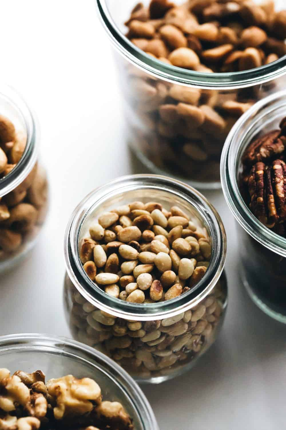 Toasted pine nuts in a glass jar