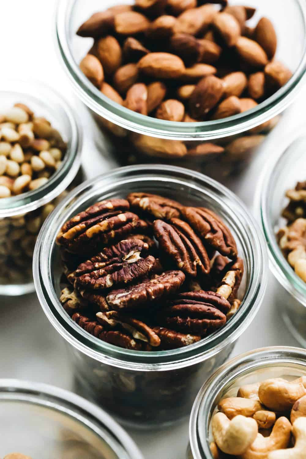 Toasted pecans in a glass jar