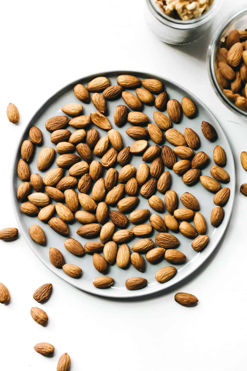 Whole almonds arranged on a plate