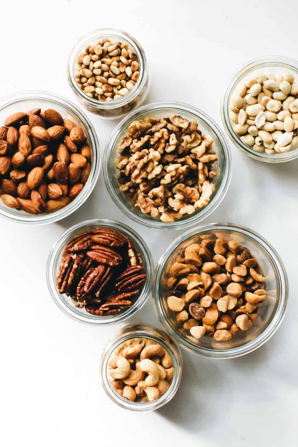 Assorted toasted nuts in glass jars