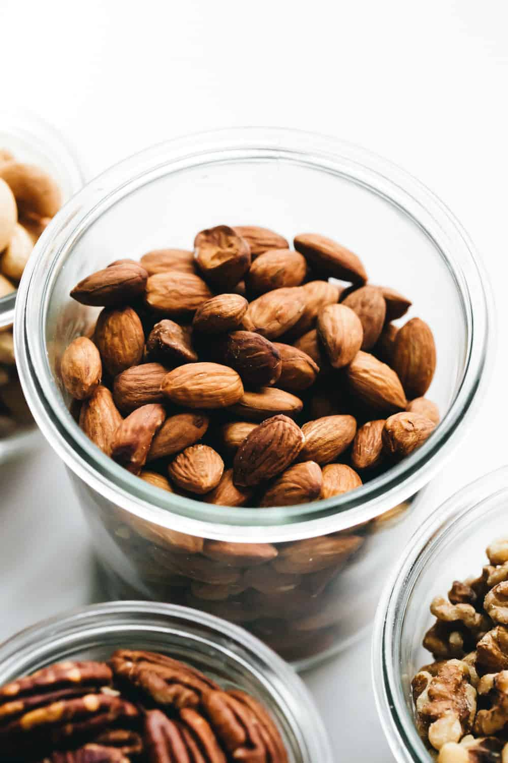 Toasted whole almonds in a glass jar