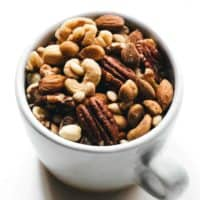 Mixed nuts in a white coffee cup