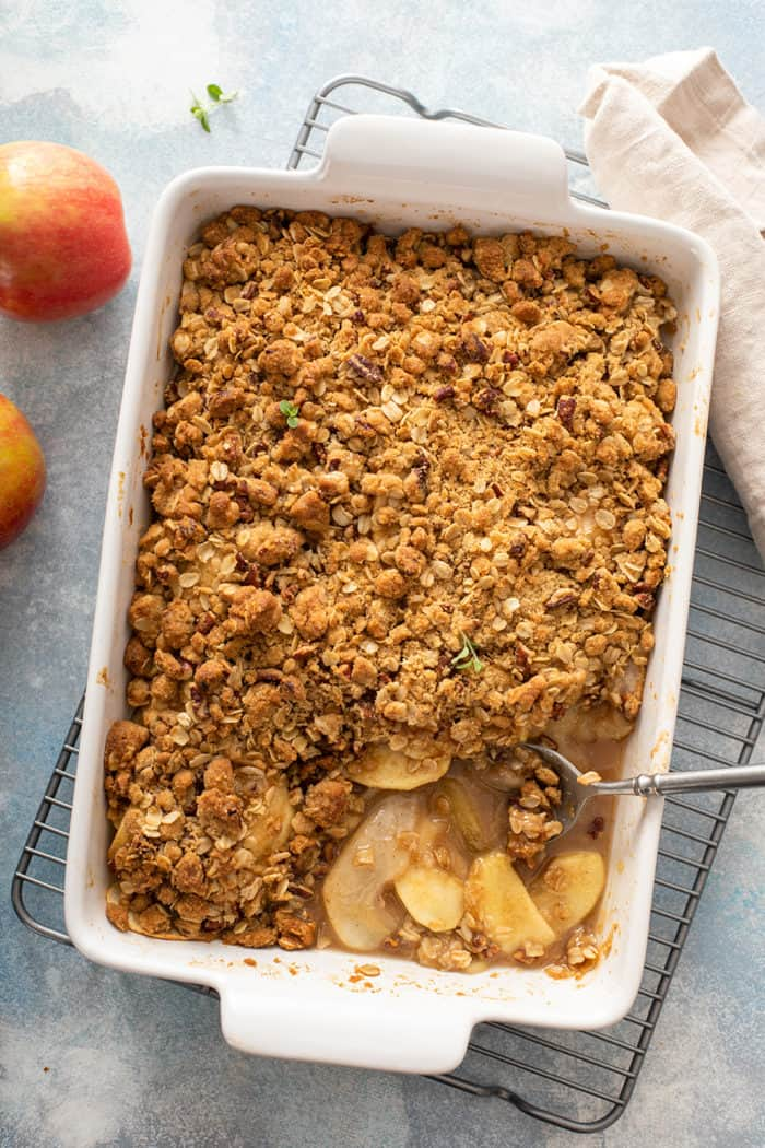 Overhead view of baked apple pear crisp with a spoonful taken out of it
