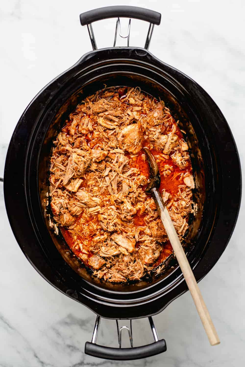 Easy Crockpot Pulled Pork spends the day slow cooking in a tangy cider vinegar sauce for pulled pork that is not only tender and flavorful, it's as easy as can be.