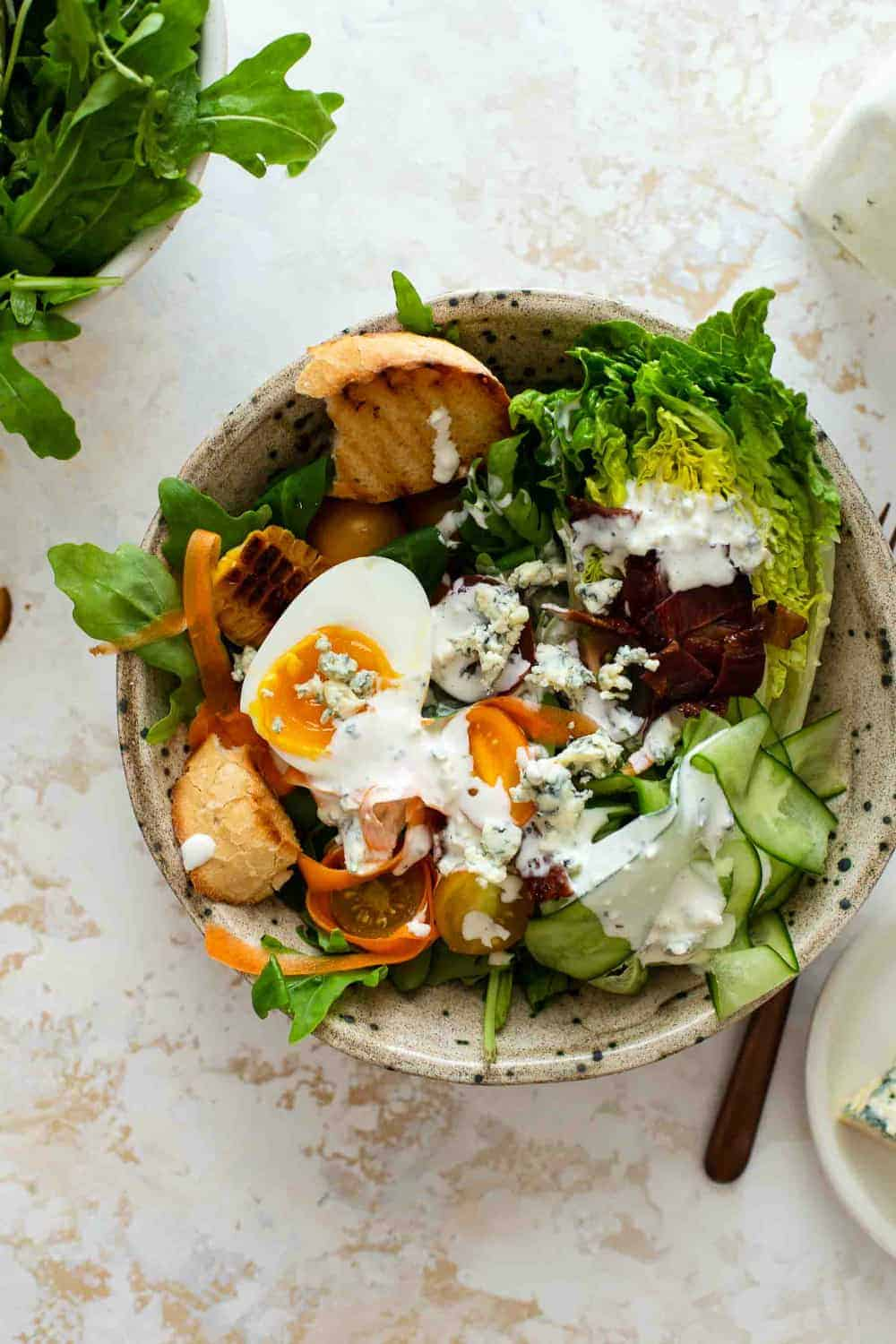 Mixed salad dressed with blue cheese dressing