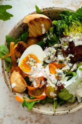 Close up of a salad dressed with blue cheese dressing