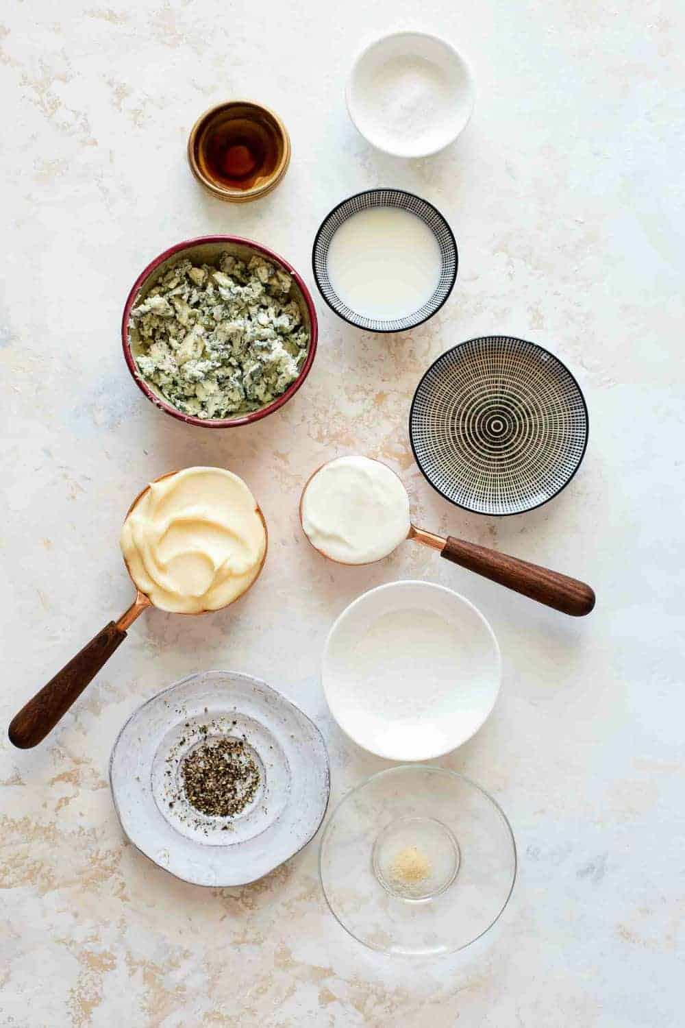 Ingredients for homemade blue cheese dressing in bowls, ready to mix