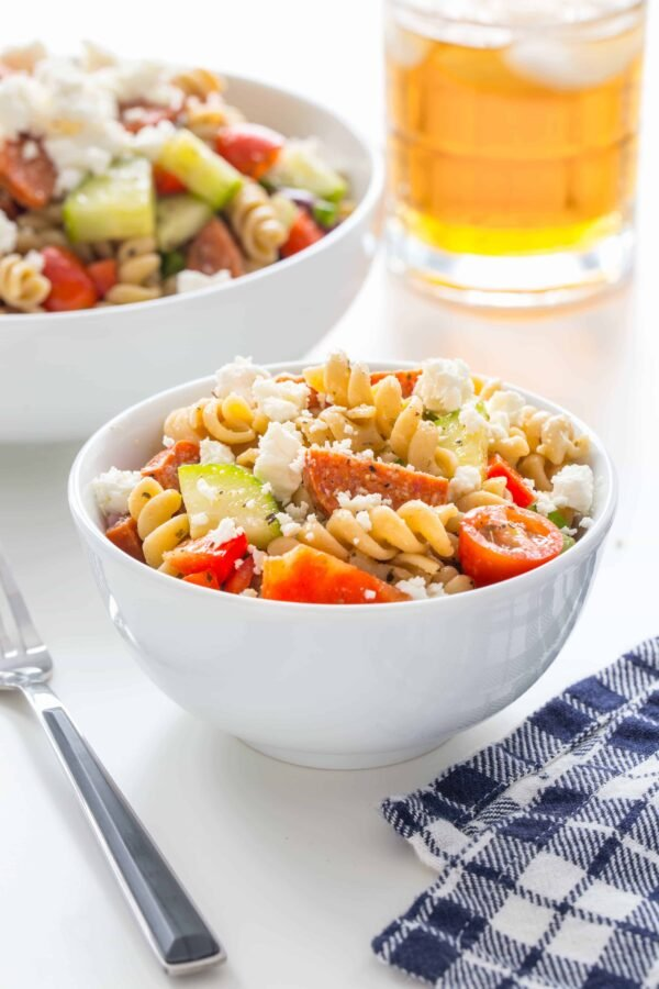 Greek Pasta Salad is loaded with fresh vegetables, feta cheese, pepperoni and a homemade Greek dressing. It's sure to become one of your new favorites!