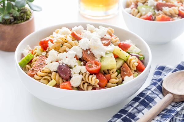 Greek Pasta Salad is loaded with fresh vegetables, feta cheese, pepperoni and a homemade Greek dressing. You'll be making this all summer long!