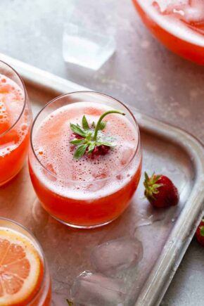 Glass of homemade strawberry lemonade garnished with a strawberry