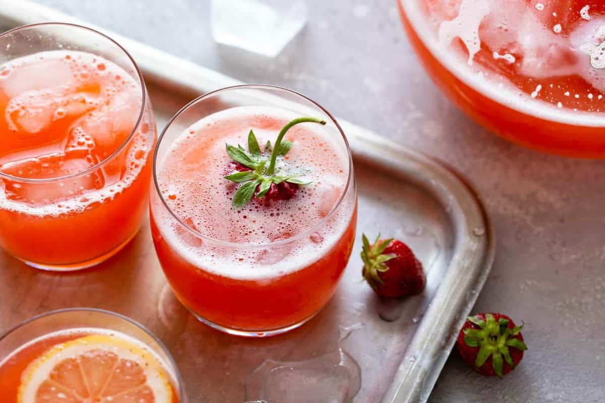 Glasses of strawberry lemonade on a sheet tray