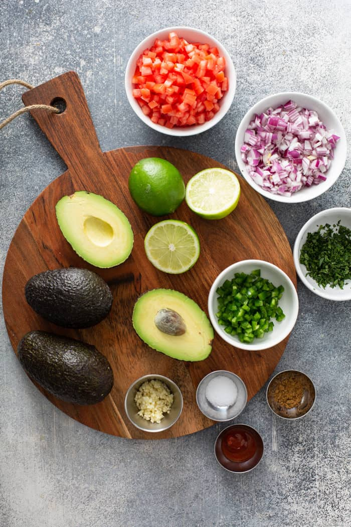 Ingredients for spicy guacamole arranged on a countertop