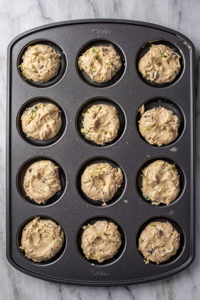 Zucchini cookie dough in a whoopie pie pan, ready to bake