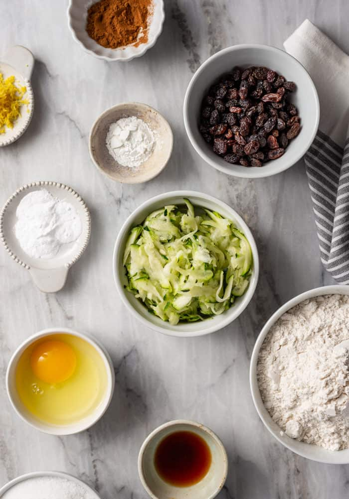 Ingredients for zucchini cookies arranged on a marble countertop