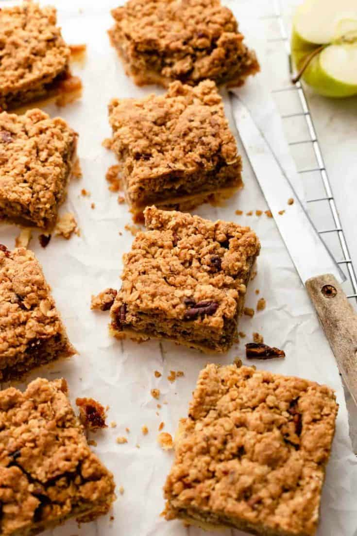 Apple Pie Bars combine a rich, buttery shortbread crust with tart apples and a nutty crumble topping for a hand-held version of apple pie that is perfect for everything from potlucks to holiday parties.