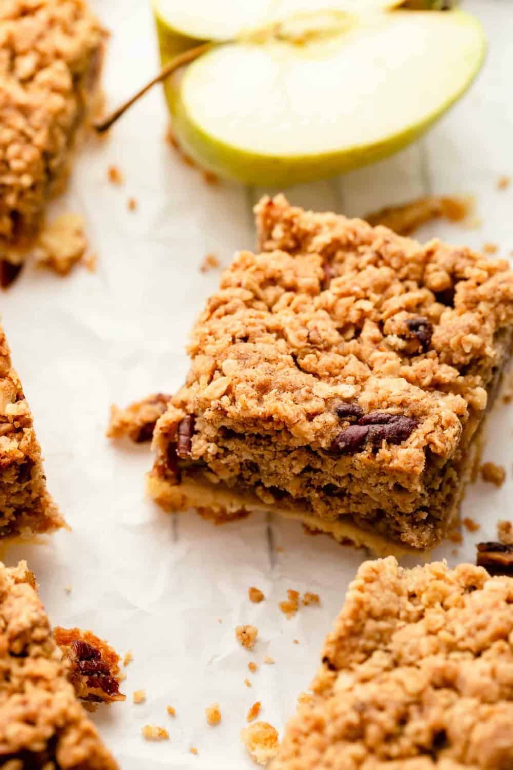 Close up of sliced apple pie bar with crumble topping