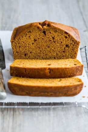 Pumpkin Bread is loaded with warm spices and full of delicious pumpkin flavor. Moist, flavorful and perfect for fall!