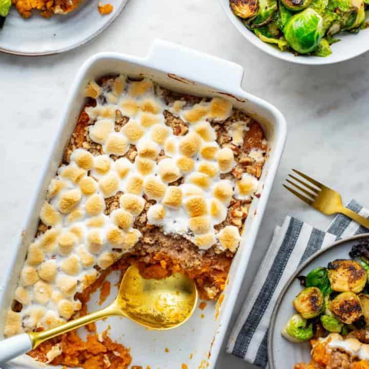 Sweet potato casserole with streusel topping in a white casserole dish