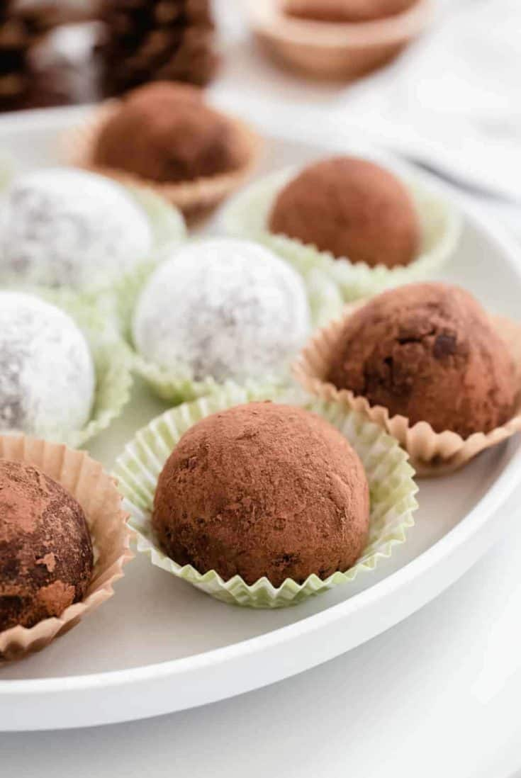 Rum Balls are a classic holiday treat. Boozy, chocolatey and rich, store these beauties in the refrigerator for several days for an even better flavor!