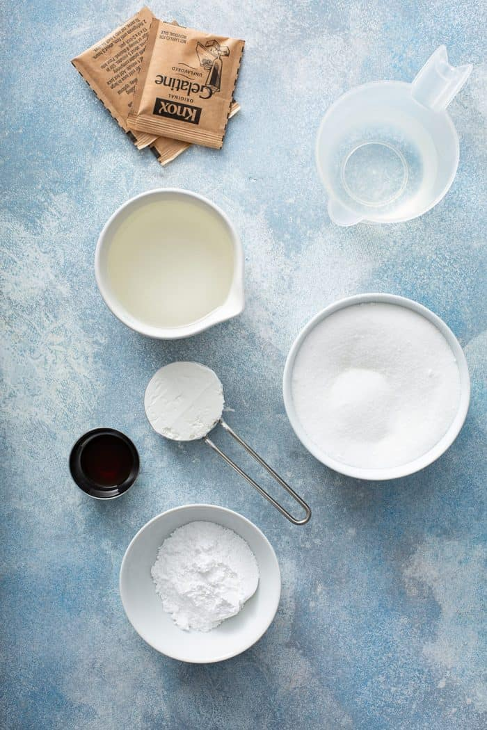Ingredients for homemade marshmallows on a blue countertop