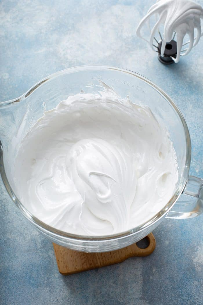 Whipped homemade marshmallow in a glass mixing bowl