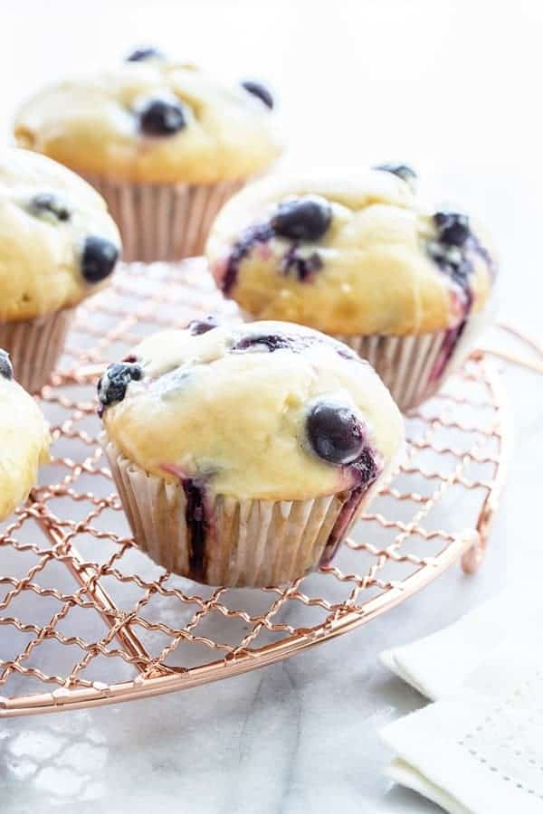 Blueberry Doughnut Muffins are topped with a sweet and tangy lemon glaze.  This is going to be your new favorite muffin recipe!