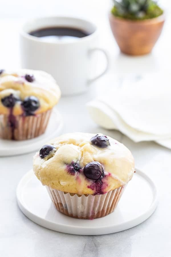 Blueberry Doughnut Muffins are topped with a sweet and tangy lemon glaze.  Your family and friends will be begging you for this recipe!