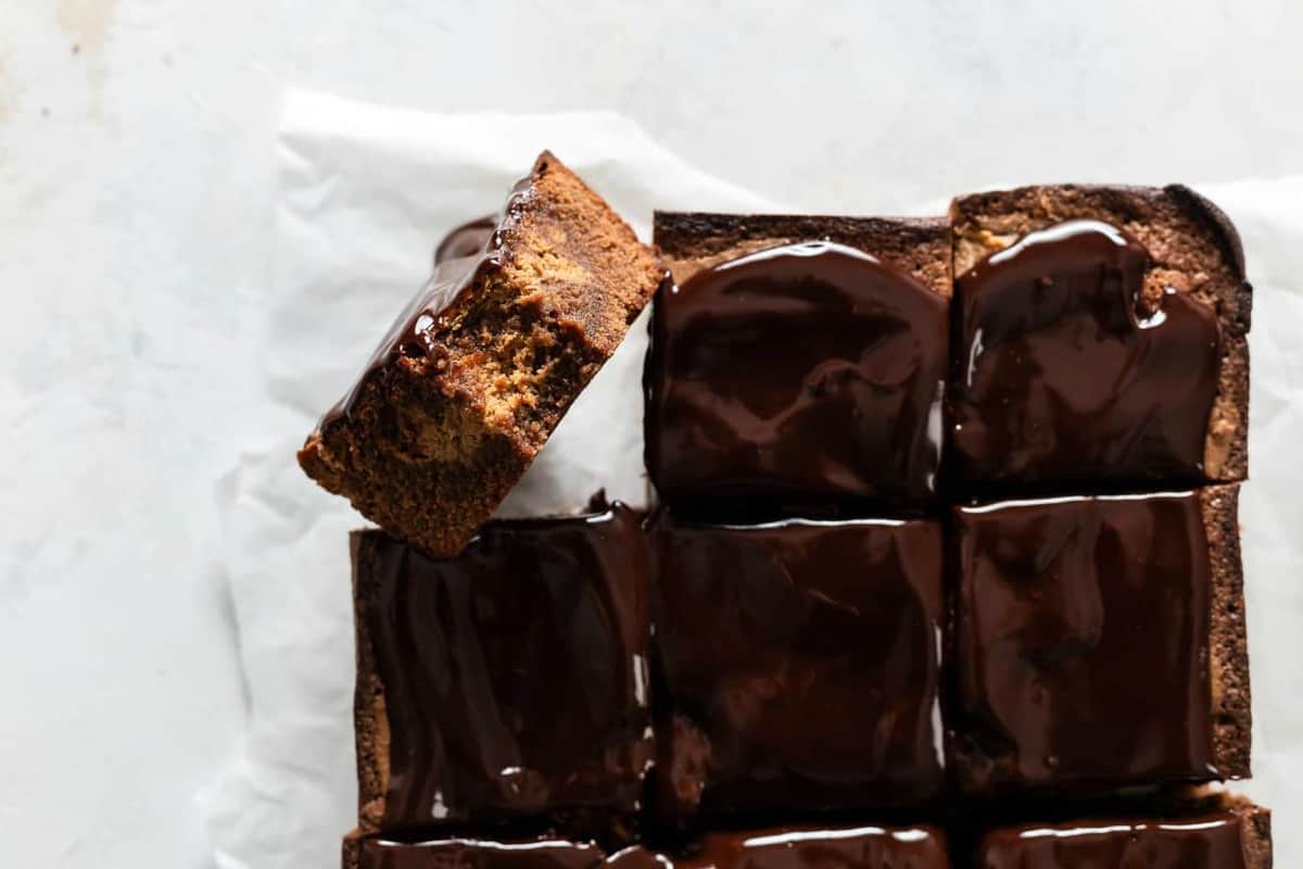 Pumpkin brownies sliced on a piece of parchment paper