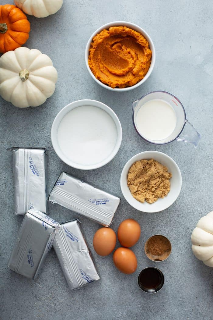 Ingredients for pumpkin cheesecake filling on a countertop
