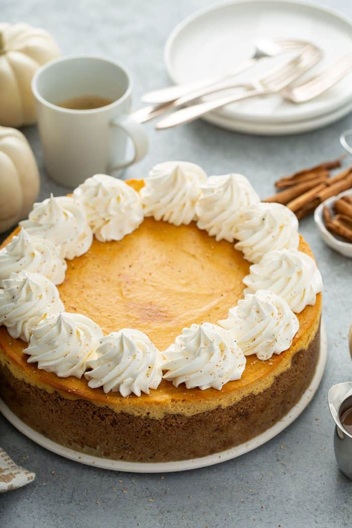 Baked and cooled pumpkin cheesecake garnished with whipped cream