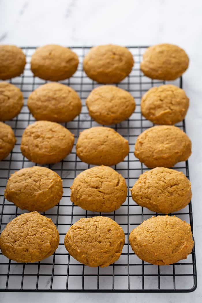 Pumpkin cookies cooling on a wire rack