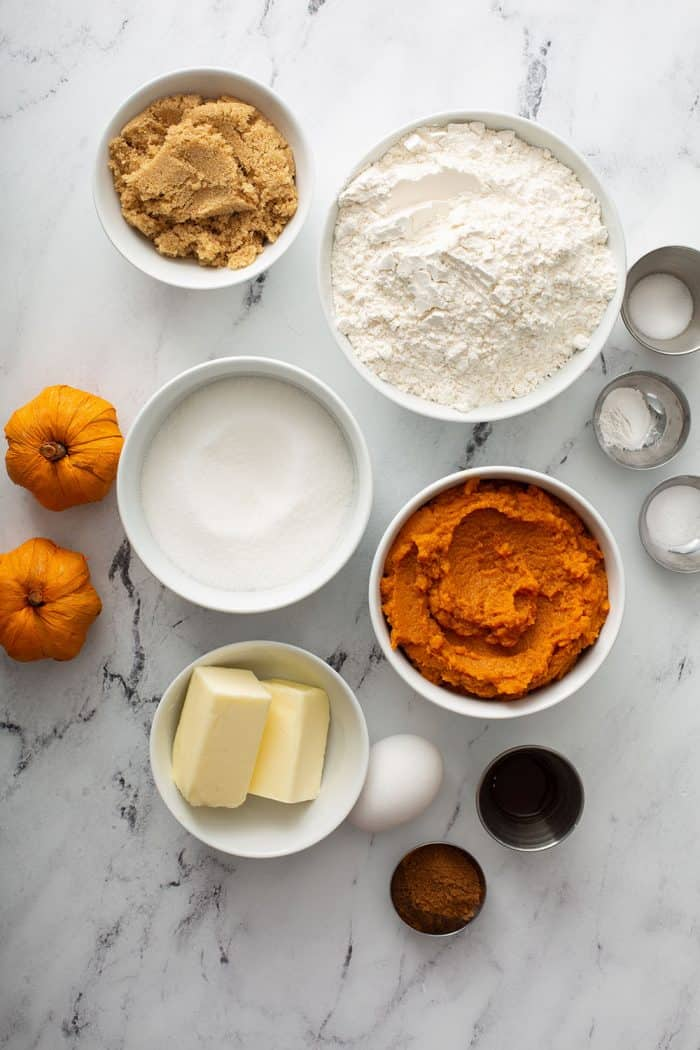 Pumpkin cookie ingredients on a marble counter