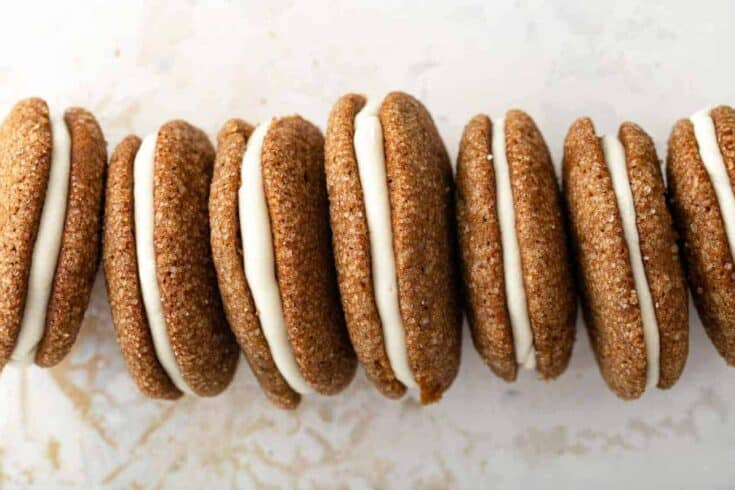 Soft and chewy pumpkin molasses cookies filled with tangy cream cheese frosting make for the best Pumpkin Molasses Sandwich Cookies.