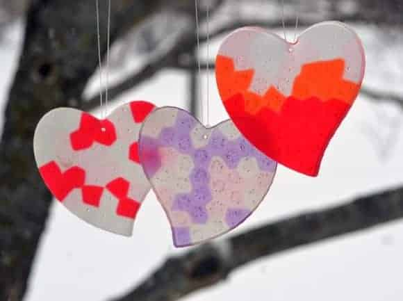 "Post image for Valentine's DIY: ""Stained Glass"" Sun Catchers & Paper Heart Wreath"
