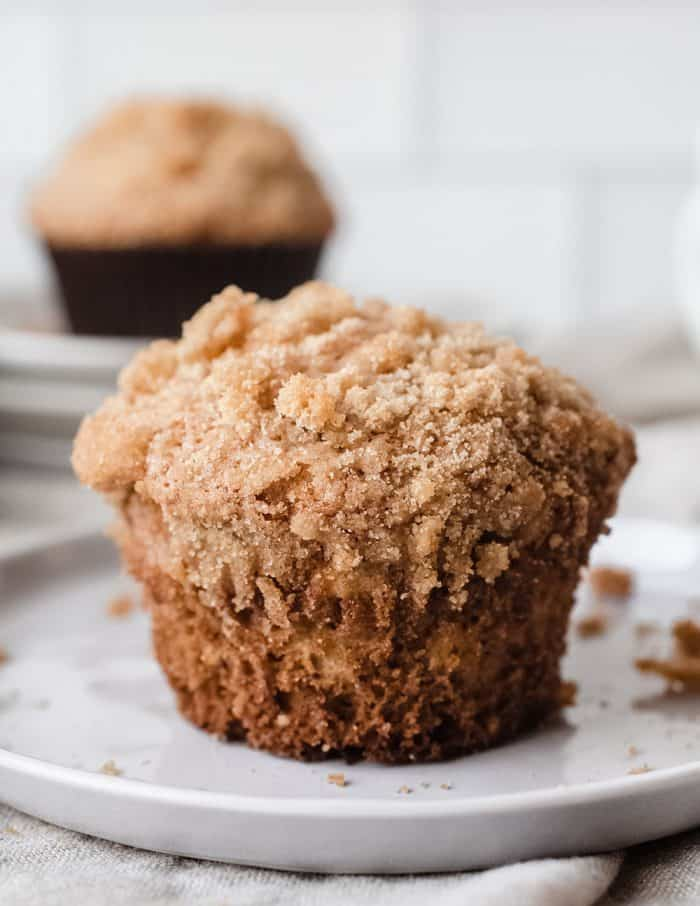 Close up of banana crumb muffin on a white plate